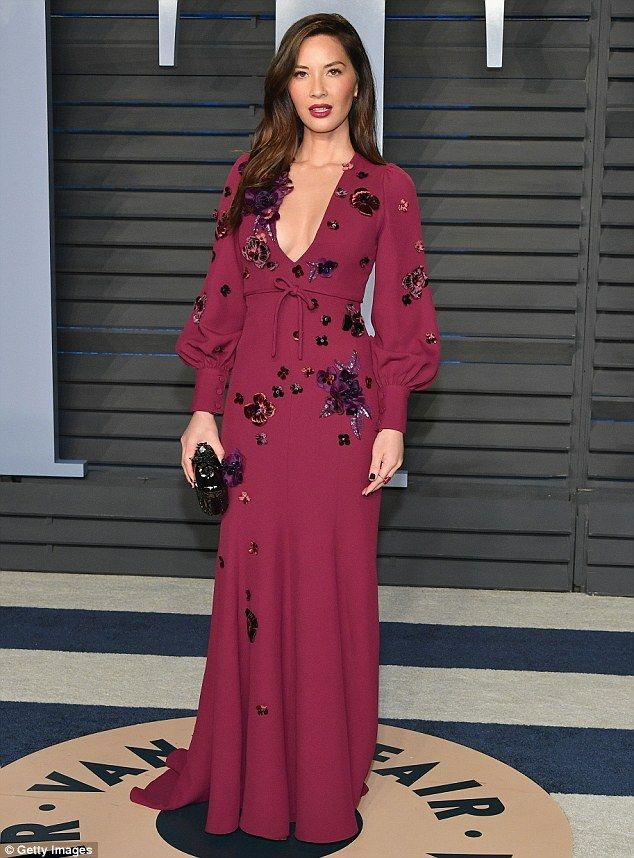 How low can you go? Olivia Munn smoldered in a plunging sangria-colored dress at Vanity Fair's annual Academy Awards after-party Sunday in Beverly Hills