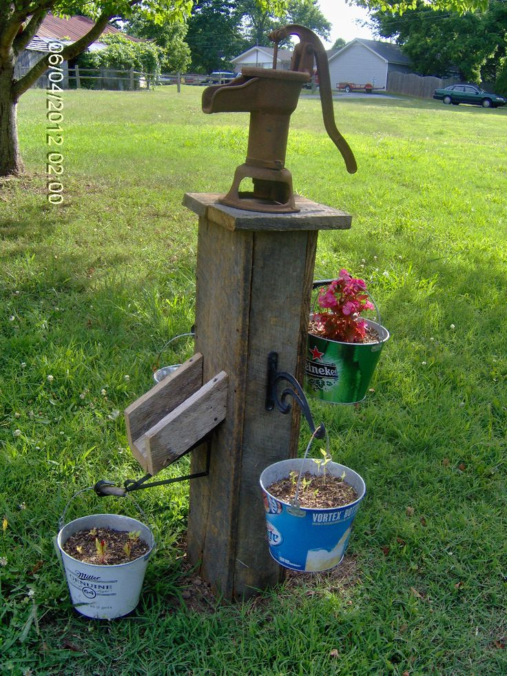 Old well pump barn wood and beer buckets gardening for Garden water pump