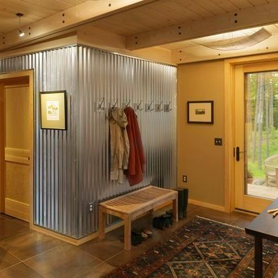 I LOVE THIS! I need to find a spot to be able to do this Corrugated Metal wall... coat hooks for next to door in basement? Wood trim on top and bottom of wall by kristy