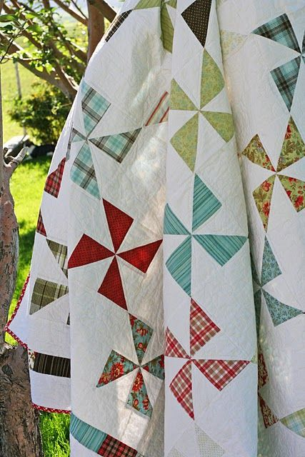 Quilt - pinwheels spaced out with white squares- yes, simple and lovely (and a heck of a lot quicker, too)