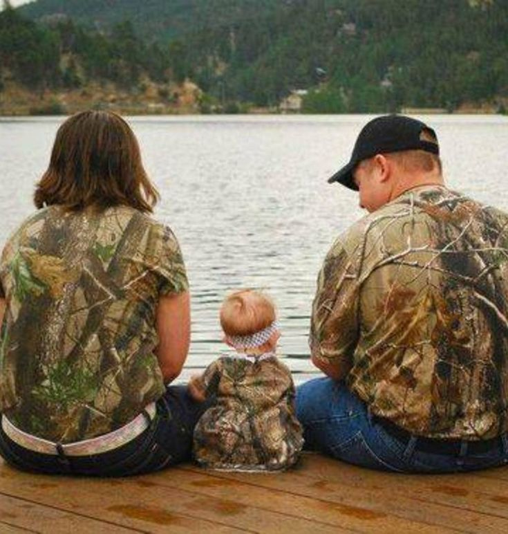 Camo Family Picture Idea.  Mom, Dad, and Baby wearing camo sitting on the dock…