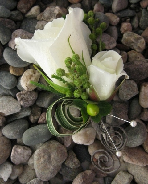 Landen's Boutonniere.  White rose + spray rose + hypericum.  Curl leftover floral tape.  Tie with thin green ribbon.