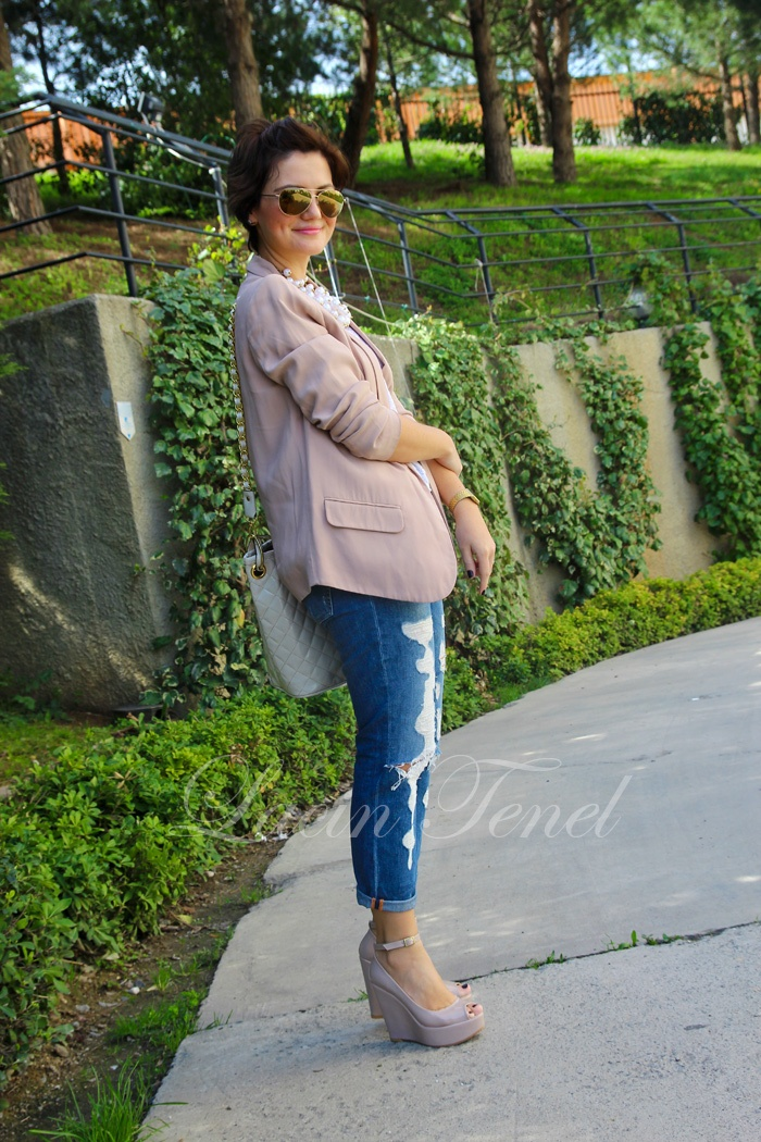 blush jacket, ripped jeans, high wedges