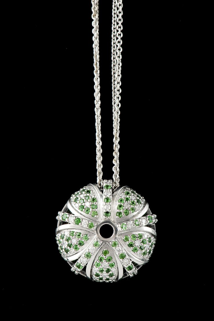 18ct white gold diamond and tsavorite garnet pendant from our 'Kina' collection.