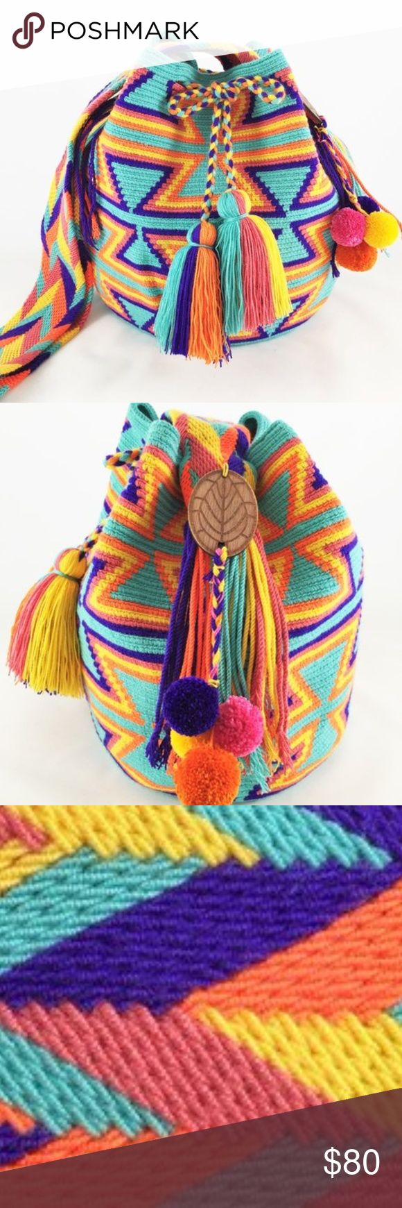 ETHNIC MULTI COLORED WAYUU BAG -AZTEC 1 This beautiful one of a kind bag is handmade by women of the Wayuu Tribe in Colombia. Wayuu Mochilas are made using hand weaving techniques that make sizes, patterns, shading and details vary.       Brand: Ecoethnic Ecoethnic Bags Shoulder Bags