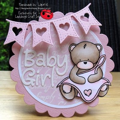 for a little baby girl , with a teddy bear