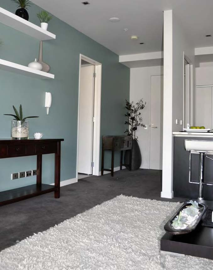 I like the grey-green-blue with sharp white contrasts - makes it pop.    Resene Metamorphis - Feature wall idea. With Barely there trims.