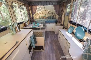 1996 Rockwood Pop Up PUP Tent Trailer RV remodel redo DIY. Light Blue and Green with grey plank flooring cushion covers bunting banners chandelier