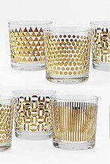 "100 Layer Cake BoutiqueMetallic Print Glassware Set Modern upgrade for the Old Fashioned. Featuring four distinct designs, the Metallic Print Glassware set is sure to catch the eye at your next get-together. Available with either silver or gold detailing, they complement any style bar.  3.4""diam. x 3.5""h. Glass with metallic detailing. Set of 4 Double Old Fashioned glasses. $34.00"