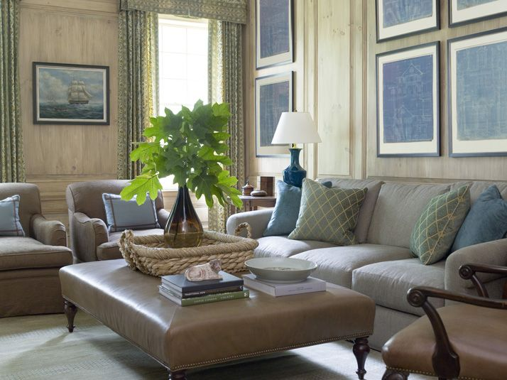 Living room featuring framed architectural blueprints - design by Phoebe Howard