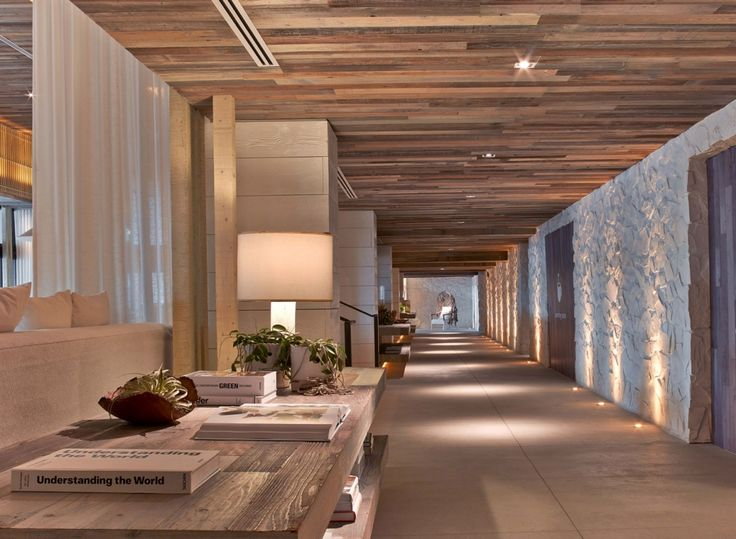 Meyer Davis — 1 Hotel South Beach. Use of sheer curtains to create spaces, timber seiling, stone and cement. great lighting.