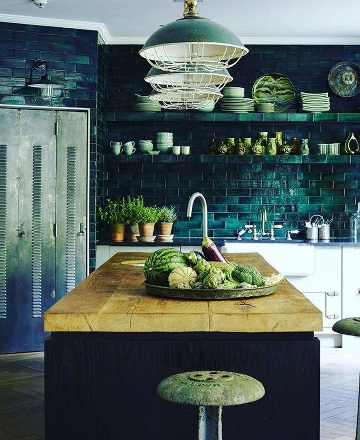 Beautiful dark kitchen, black tiles, wooden woktop