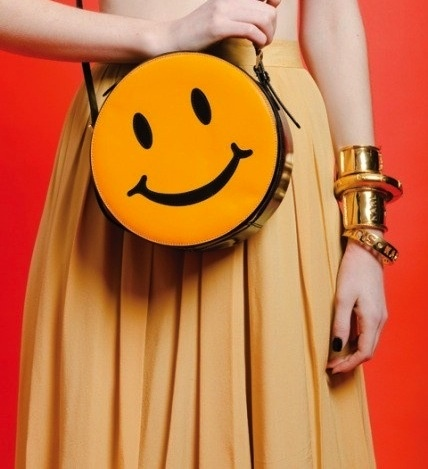 We'd rock this cute vintage Moschino happy face purse in a heartbeat!