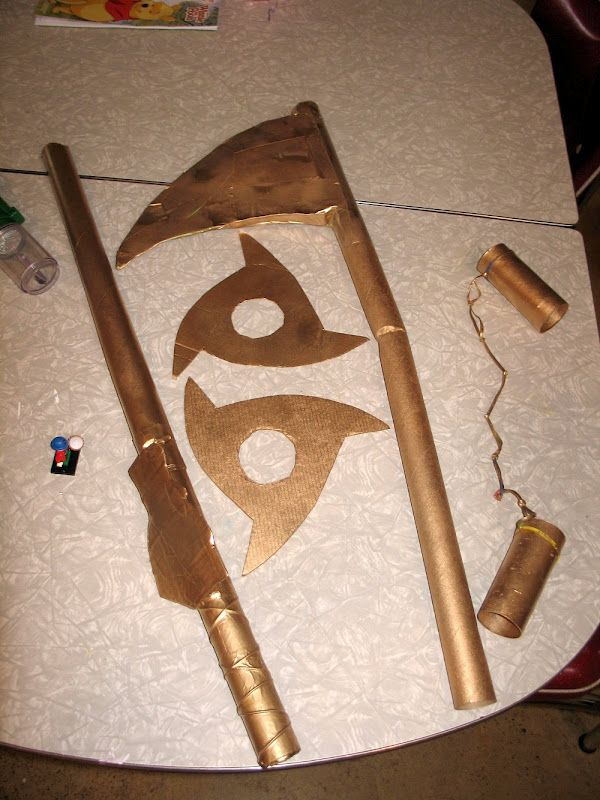 Ninjago Weapons made from toilet paper tubes, wrapping paper tubes, paper towels tubes, cardboard, duct tape and gold spray paint.