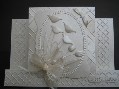 This Card Was Made Using The Following Dies.  Prim Poppy Memory Box  Dancing Tulips Memory Box.  Tessatina Border Memory Box  Debutante Frame Memory Box  Bow Maker