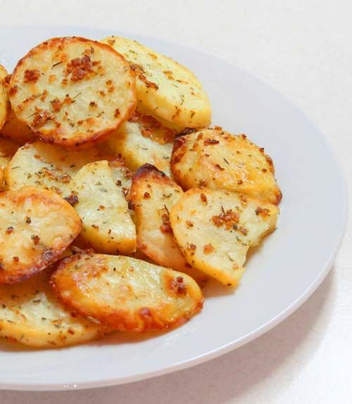 Baked Garlic Potato Slices -Simple and healthy snack to make. Just sliced up potatoes, sprinkled with salt, garlic, and seasoning. Then baked in oven.