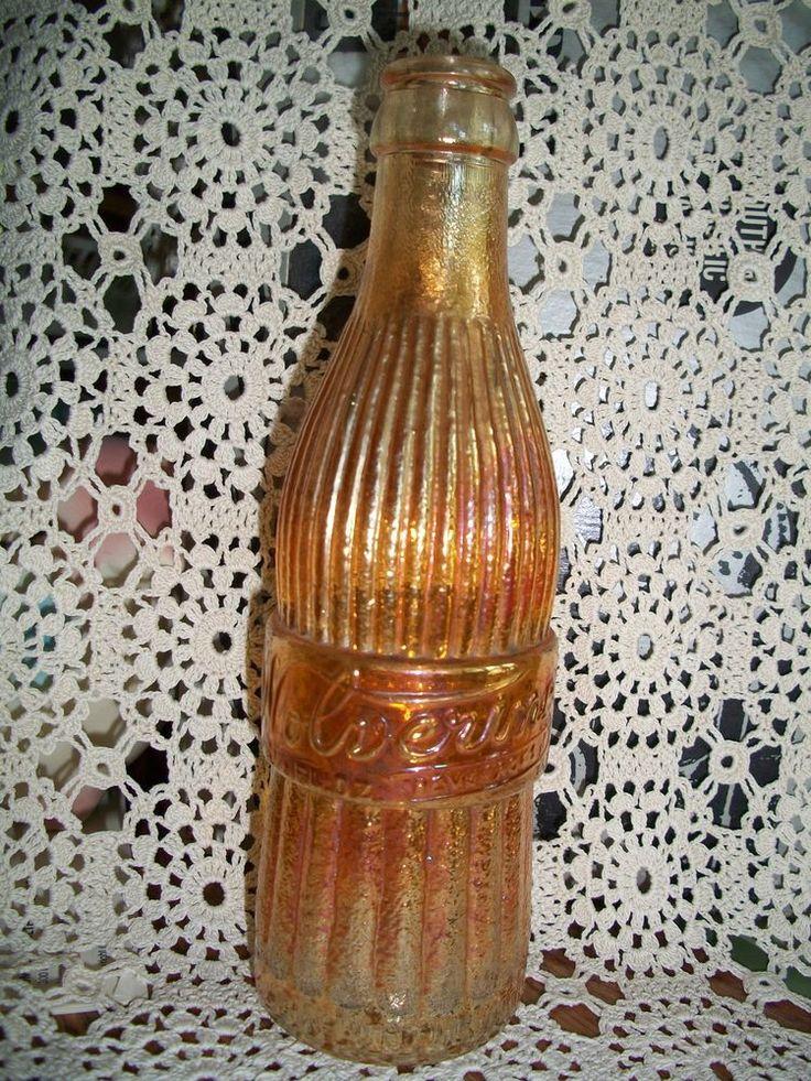 OLD  WOLVERINE 1930's & 40's pop, soda bottle, orange carnival glass.Detroit,MI. $128.28?  Wow!