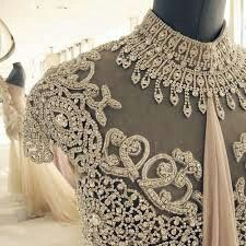 Francis Libiran Elegant and super classy look in white with silver mirror work and net. #Indianwedding, #ShaadiShop