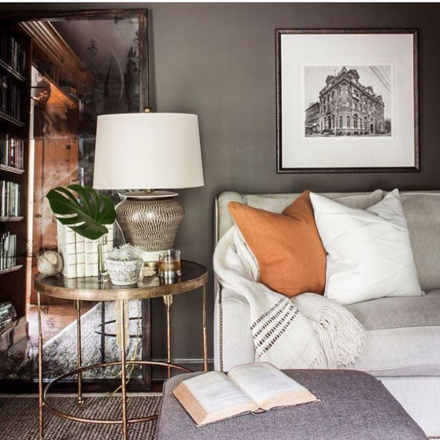 A beautifully layered & collected space designed by @seanandersondesign. Love the impact the ginger pillow makes here!