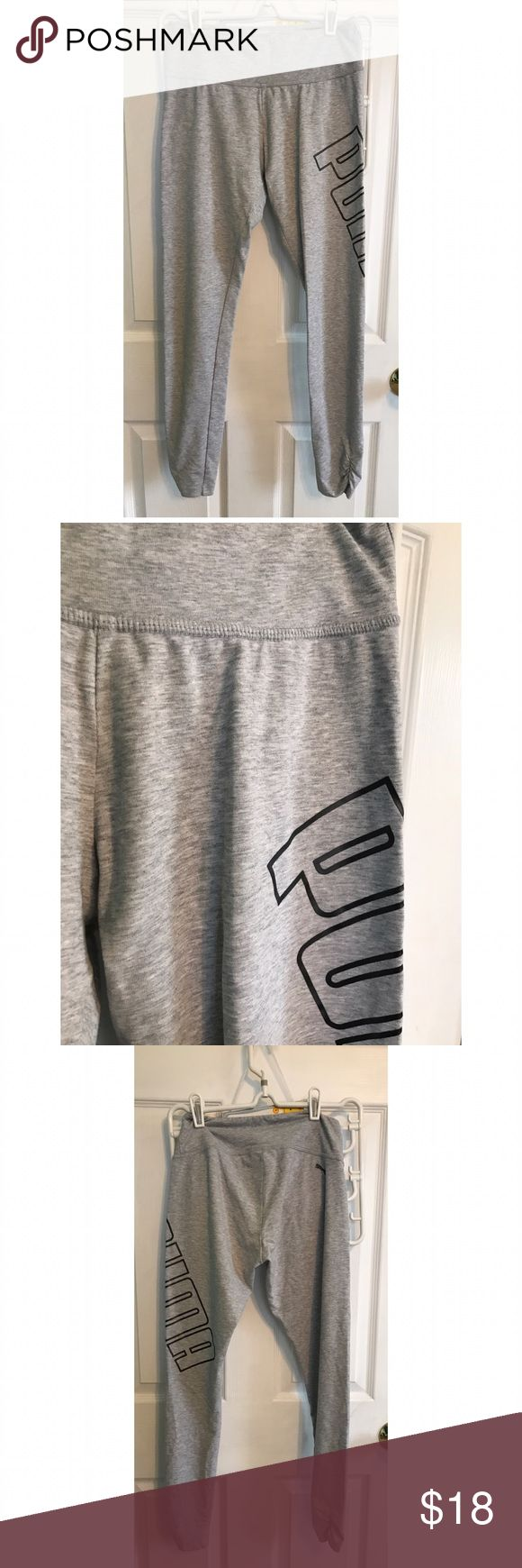 Puma leggings -Puma  -Ladies leggings  -Special Features   •puma logo wraps around side of leg  •sinched bottoms -Size Small  -Black logo on grey -Used but In Perfect Condition besides,  •two little brown spots on the butt (as seen above) Ask if any questions! Taking reasonable offers! Puma Pants Leggings