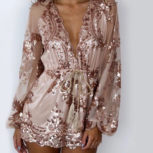 Gold sequin romper. Beautiful gold sequin romper! In perfect condition! Tassel (belt) is not included. This is a size M Dresses