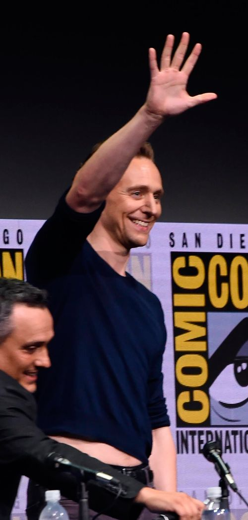 Tom Hiddleston attends the Marvel Studios Presentation during Comic-Con International 2017 at San Diego Convention Center on July 22. Wearing the TOO short sweater again to flash the fangirls bastard