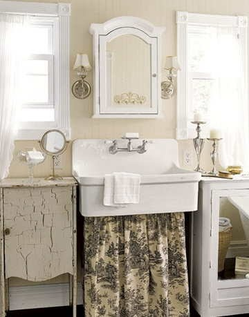 Photo Album Website A new master bathroom looks original thanks to its apron front sink with toile skirt old record cabinets provide storage I need to find a sink like this