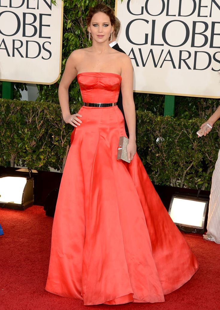 Jennifer Lawrence looks amazing in Dior Haute Couture gown. I love the peachy/red color and the belt goes great with it!