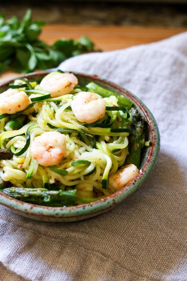 Garlic shrimp and fresh asparagus sautéed and served over zucchini noodle pasta.