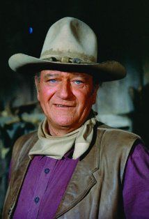 John Wayne -John Wayne (born Marion Morrison) was the son of pharmacist Clyde Morrison and his wife Mary. Clyde developed a lung condition that required him to move his family from Iowa to the warmer climate of southern California, where they tried ranching in the Mojave Desert. Until the ranch failed, Marion and his younger brother Robert E. Morrison swam in an irrigation ditch and rode a horse to school...Love all of his movies