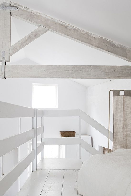 A cozy, bright white loft. I could just curl up here.