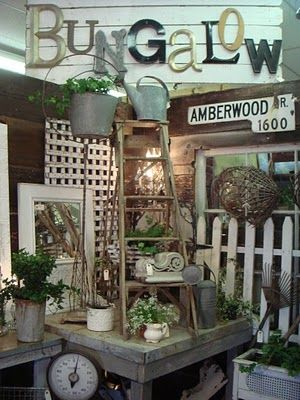 Not all of these elements together--but individually they are great--ladder, tin can, greenery, picket fence, typography, framed mirror, rustic table