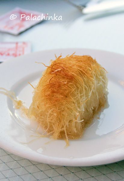 A kadaif pastry is made by putting down a layer of 'wire' kadaif, then a layer of a filling of chopped nuts, then another layer of wire kadaif. The pastries are painted with melted butter, baked until golden brown, then drenched in sugar or honey syrup.
