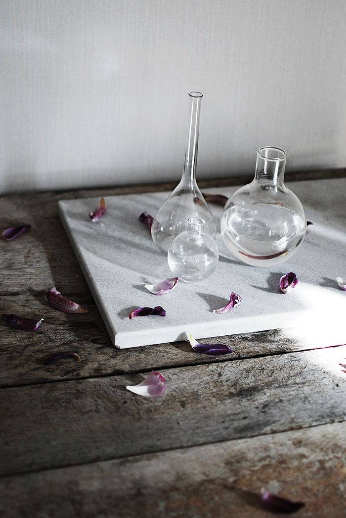withered tulips on marble and our antique butcher table