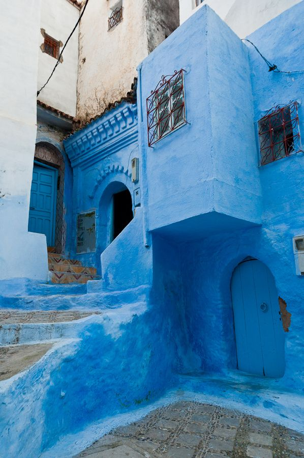Africa | A view of one of the many blue-painted streets in Chefchaouen, Morocco. Chefchaouen is situated in the Rif Mountains, just inland from Tangier | © Mark Fischer