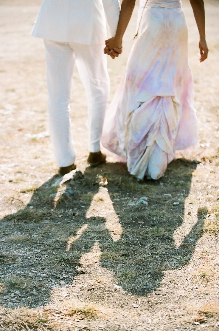 austin wedding; texas wedding; rock n roll wedding; desert wedding; ranch wedding; q weddings; bz events; Three Points Ranch; groom in white suit; bride in white and lavender dress;