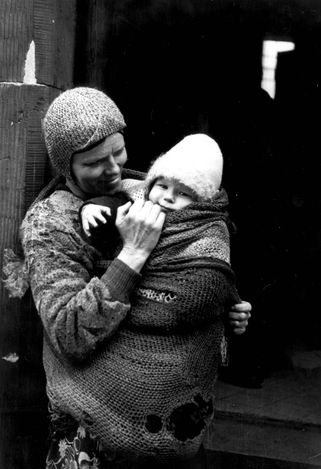 Warsaw, Poland, A woman holding a baby.  One of the photographs taken by the German photographer Willi George over the course of a single day in the summer of 1941. The photographs are unique in that they were not staged, but showed the ghetto as it truly was