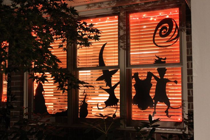 Nightmare Before Christmas...Cut-outs taped to the window with a dollar store orange tablecloth hanging from the window.