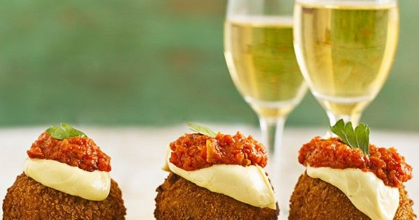 The best canapé using mashed potato. Pork mince wrapped in mash makes an easy nibble that's coated in breadcrumbs and served with spicy tomato sauce and aïoli. It's the creation of genius Spanish chef Jose Pizarro who has a tapas bar and restaurant on Bermondsey Street, London.