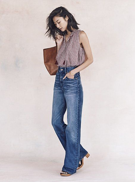 High-waisted flared jeans and a printed top.