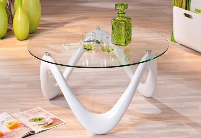 Couchtisch. Der Couchtisch bietet Ihnen eine großzügige Rundfläche zur Ablage und erweist sich als unverzichtbarer Begleiter entspannender Abende im eigenen Wohnzimmer. Die herausragende Besonderheit des Couchtisches stellt der Fuß des Tisches dar, welcher in Hochglanzoptik aus hochwertigem Kunststoff auftritt und eine wellenähnliche, in sich geschlossene Form besitzt, die symmetrisch verläuft