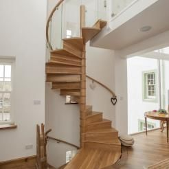American white oak spiral staircase which rises through 2 flights for the refurbishment of a manse in Scotland