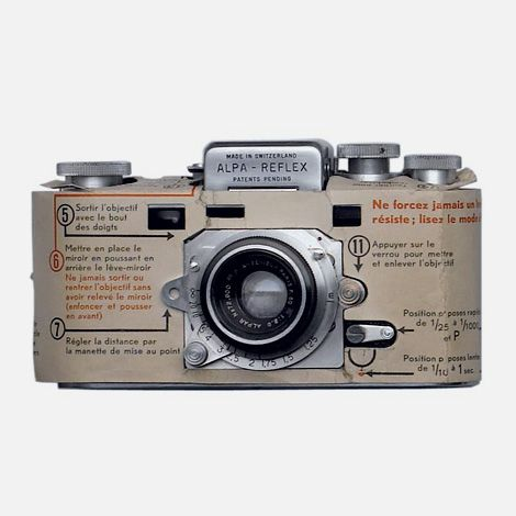 Alpa Reflex Camera with printed manual, designed 1944. Switzerland. Photo: Hans Hansen, Hamburg. Via Design is fine.