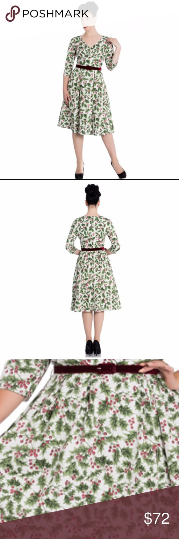 Holly Berry Holiday Pinup Rockabilly Skirt Retro 1950's dress by Hell Bunny with print of holly on a white background. Zip at the centre back to fasten. V neck front and high back. Comes with a detachable, dark red velvet belt. 98% Cotton, 2% Elastane Hell Bunny Dresses Midi