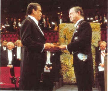 Derek Walcott receives his Nobel Prize for Literature from the King of Sweden,   King Carl XVII Gustaff - in December 1992