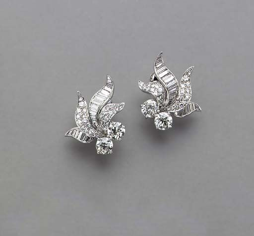 A PAIR OF DIAMOND AND PLATINUM EAR CLIPS 4 old European-cut diamonds, weighing approximately 1.00-1.25 carats total, H/I/J color, VS-SI clarity, I clarity 48 circular and 34 baguette-cut diamonds, weighing approximately 3.25-3.75 carats total, G/H/I color VVS-VS calrity