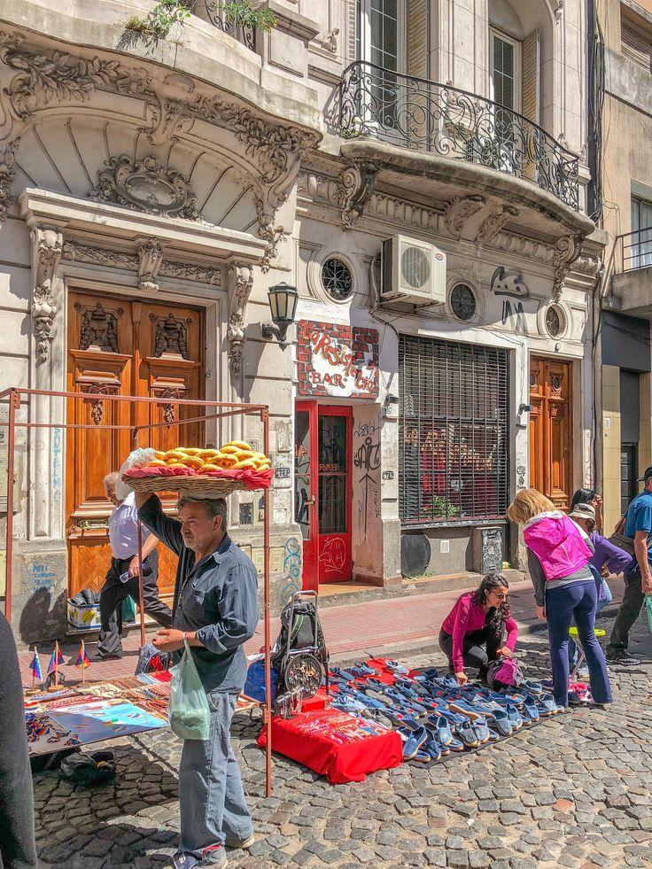 A vendor roams the San Telmo Fair in Buenos Aires selling snacks.