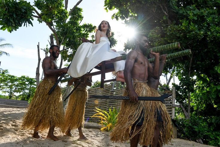 Fijian warriors carrying the bride to the wedding ceremony Paradise Cove Island Resort, Yasawa, Fiji. Photographed by Anais Photography.