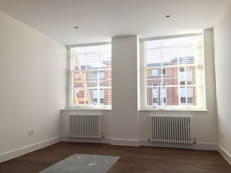 Wood venetian blinds in pure white colour fitted to yoga studio in London | Blinds for sash windows | Modern blinds | Wooden slat blinds | Commercial blinds | Made to measure