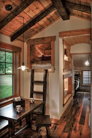 Plank ceiling with faux fiberglass beams, a wood floor and wood trim around the window casements...Bunk beds